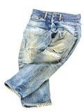 Vecchi pantaloni utilizzati dei jeans isolati fotografia stock