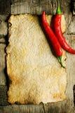 Vecchi peperoni di peperoncino rosso e del documento Fotografia Stock Libera da Diritti