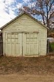 Vecchi portelli del garage Immagini Stock