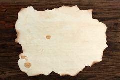 Vecchi punti di legno bruciati spazio in bianco di carta Immagini Stock Libere da Diritti