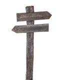 Vecchi segnali stradali di legno, entrambe le frecce isolate Fotografie Stock Libere da Diritti