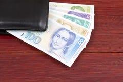 Vecchi soldi da Germania Occidentale nel portafoglio nero Immagine Stock