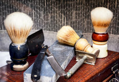 Vecchi strumenti del barbiere Immagini Stock
