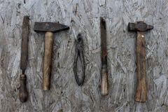 Vecchi strumenti sullo scrittorio Immagini Stock