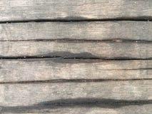 Vecchi tenore d'acqua e sabbia marroni del bordo di legno fotografia stock libera da diritti