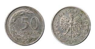 Vecchi usati cinquanta groszy polacchi coniano isolato su fondo bianco immagine stock