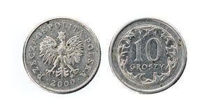 Vecchi usati dieci groszy polacchi coniano isolato su fondo bianco fotografia stock libera da diritti