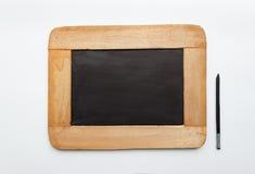 Vecchia ardesia in bianco e matita del blocco per grafici di legno dell'annata Fotografia Stock Libera da Diritti