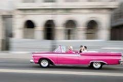 Vecchia automobile convertibile rosa Fotografia Stock