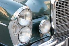 Vecchia automobile del faro Immagine Stock