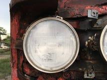 Vecchia automobile del faro Immagine Stock Libera da Diritti