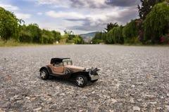 vecchia automobile del giocattolo di 1900s Immagini Stock Libere da Diritti