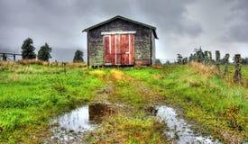 Vecchia baracca nelle montagne Fotografia Stock