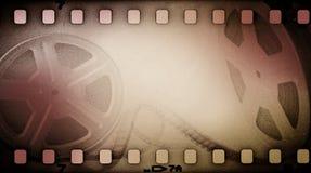 Vecchia bobina cinematografica di lerciume con la striscia di pellicola Fotografia Stock