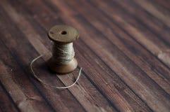 Vecchia bobina su backround di legno Fotografia Stock Libera da Diritti