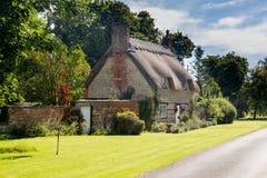 Vecchia casa della pietra del cotswold in Honington Immagine Stock