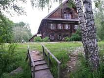 Vecchia casa di legno russa Immagini Stock