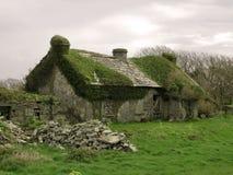 Vecchia casa di pietra abbandonata Fotografia Stock