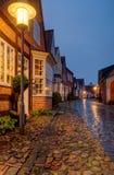 Vecchia casa tradizionale alla via bagnata di Uldgade in Toender Danimarca Immagine Stock Libera da Diritti