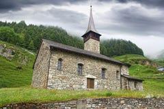 Vecchia chiesa di pietra in Andermatt, Svizzera Fotografie Stock