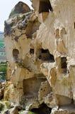 Vecchia città della caverna in Cavusin, Cappadocia, Turchia Fotografie Stock