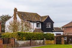 Vecchia costruzione con la facciata nera a Somerset Fotografia Stock