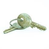 Vecchia e chiave arrugginita isolata Fotografia Stock