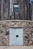 Vecchia entrata della parete esterna del mulino a vento Fotografie Stock