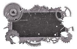 Vecchia etichetta dello spazio in bianco grigio scuro del metallo in ingranaggi su bianco Immagine Stock