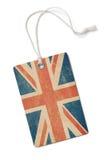 Vecchia etichetta di carta del panno con la bandiera della Gran Bretagna isolata Immagine Stock
