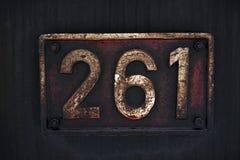 Vecchia etichetta di numero del metallo Fotografia Stock Libera da Diritti