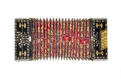 Vecchia fisarmonica isolata Armonica d'annata Retro fisarmonica del bottone Fotografie Stock Libere da Diritti