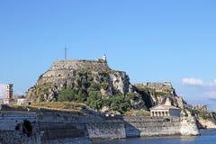Vecchia fortezza con la torre di orologio ed il faro Corfù Fotografia Stock Libera da Diritti