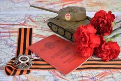 Vecchia identificazione sovietica dei militari, ordine della guerra patriottica in st Georg Immagine Stock