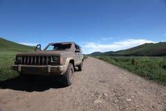 Vecchia jeep sporca Immagine Stock