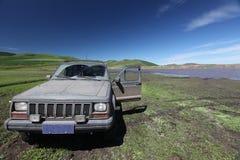 Vecchia jeep sporca Fotografie Stock