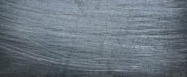 Vecchia lamiera di ferro scura, struttura del metallo del cromo come fondo Fotografie Stock