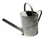 Vecchia latta di innaffiatura rustica del metallo Fotografia Stock