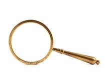 Vecchia lente d'ingrandimento del metallo isolata Fotografia Stock
