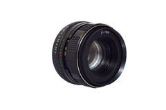 Vecchia lente del manuale 50mm isolata Fotografia Stock