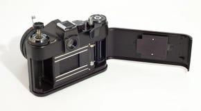 Vecchia macchina fotografica della foto di SLR. Corpo aperto fotografia stock libera da diritti