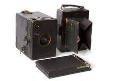 Vecchia macchina fotografica della foto isolata su bianco Fotografia Stock