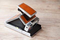 Vecchia macchina fotografica istante immagini stock libere da diritti