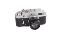 Vecchia macchina fotografica manuale su fondo bianco Immagine Stock