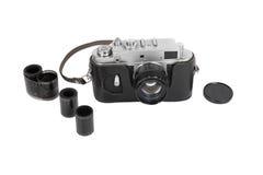 Vecchia macchina fotografica manuale su fondo bianco Fotografie Stock