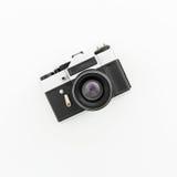 Vecchia macchina fotografica su bianco Disposizione piana, vista superiore Fotografie Stock