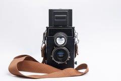 Vecchia macchina fotografica su un fondo bianco Fotografia Stock