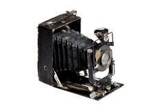 Vecchia macchina fotografica sui precedenti bianchi Fotografia Stock