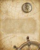Vecchia mappa nautica con la bussola ed il volante Fotografia Stock