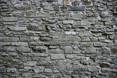 Vecchia massoneria grigia della parete di pietra del grunge antico Fotografie Stock